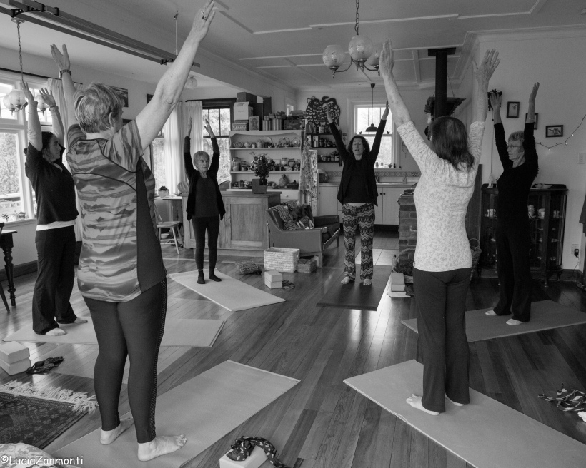 image of a women at a yoga class in a home